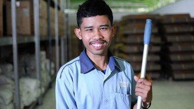 A man holds a mop