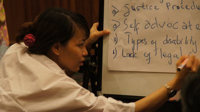 A woman writes on a flip chart