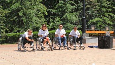 Wheelchair users play bocce ball