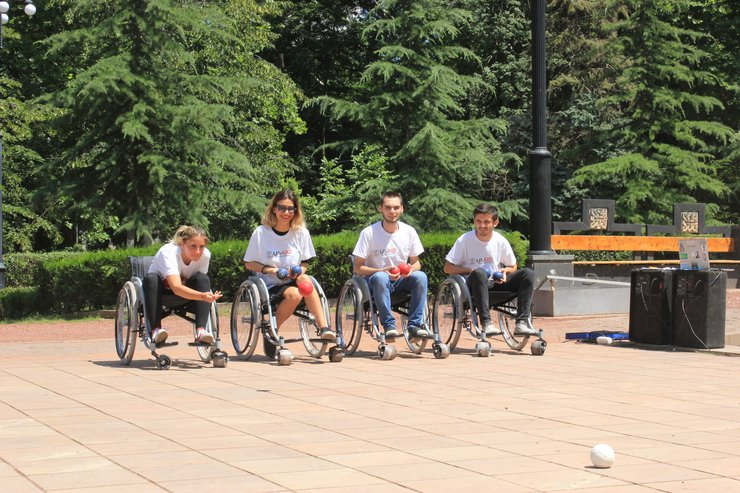 Wheelchair users play bocce ball