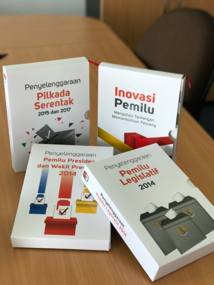 Four books with titles in Bahasa Indonesian sit on a counter