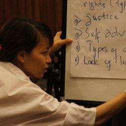 A woman writes on a flip chart