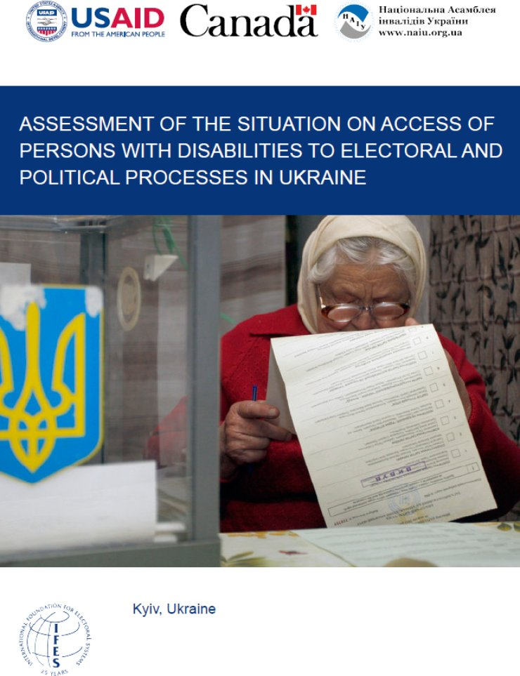 An older woman looks down at a ballot in a Ukrainian polling room