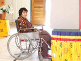 The front cover of the publication shows a woman using a wheelchair infront of a polling booth. She is looking toward the camera with a soft smile and wearing a brown patterned dress..