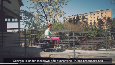 Screenshot from the PSA video produced by IFES featuring Tinatin Revazashvili, a young woman wheelchair user in Georgia going down a ramp.