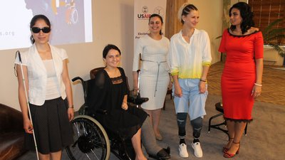 Women with disabilities smile at the camera