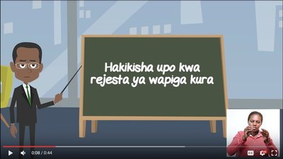 A cartoon man stands at a chalk board and points to words in Kiswahili