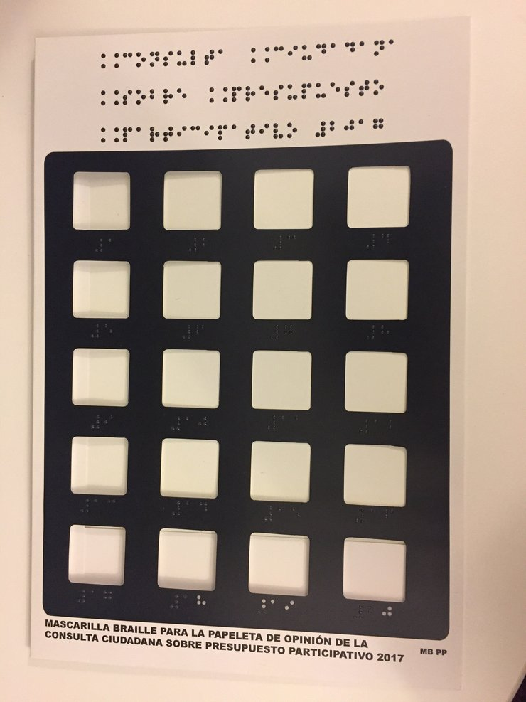 Ballot guide with braille and 20 windows