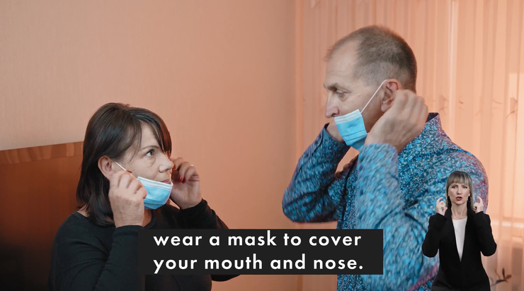 A man and woman putting on a face mask before going to the polling station.