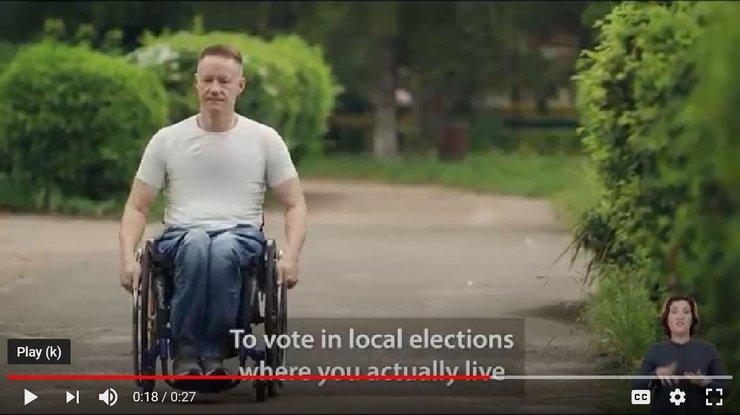 Screenshot showing a man using a wheelchair in Ukraine.