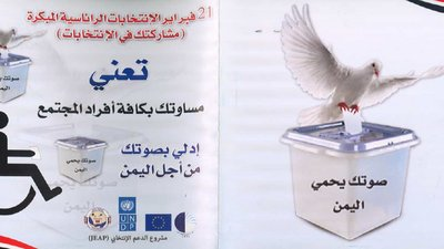 The front and back cover is shown. The front cover (on the left) has a universal symbol of a wheelchair user, which is depositing a ballot. There is Arabic writing. On the back cover is a large photo of a dove putting a ballot inside a box.