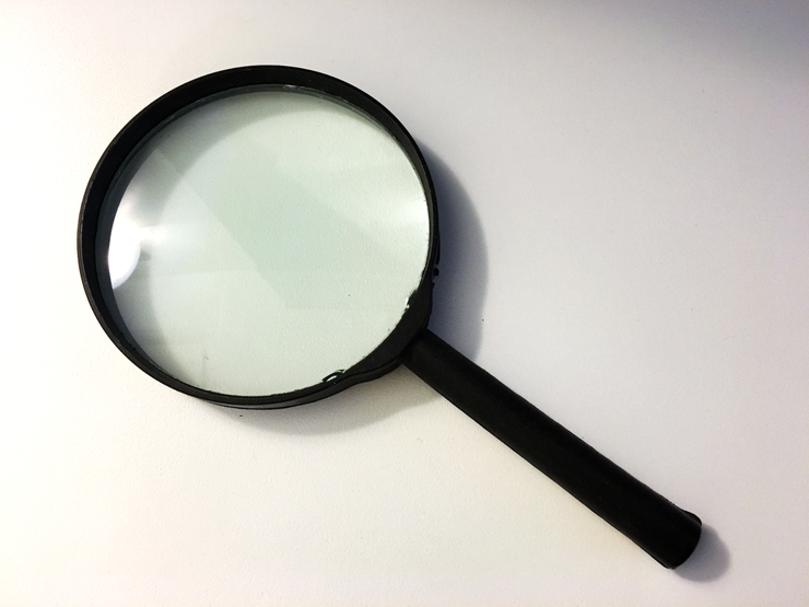 A black magnifying glass